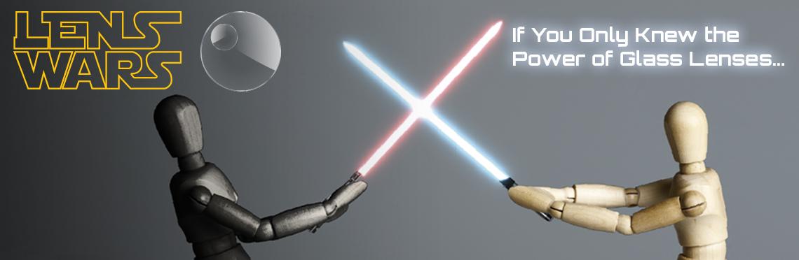 Lens Wars image. Two wooden figures have a lightsaber duel