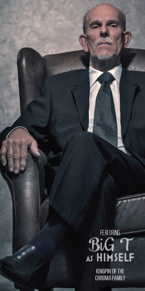 Stodgy older looking gentleman sitting in a chair