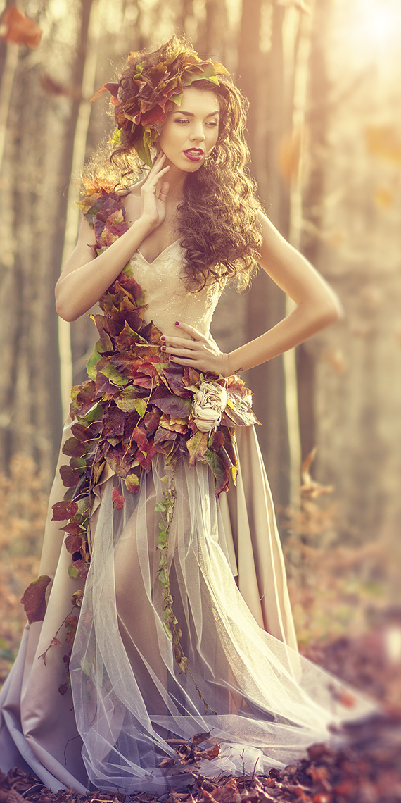Image of a woman in the woods with autumn dressings