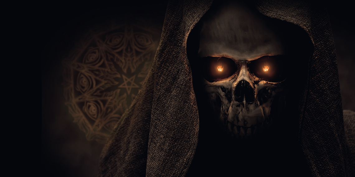 Image of a skull with a hood and fire in it's eyes