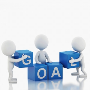 Picture of generic characters holding and assembling blocks with letters on the that spell the word 'goal'