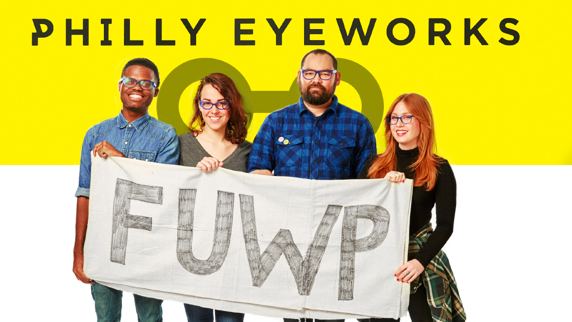 "Hero image for article ""Philly Eyeworks:"". Two men, and two woman holding a handmade sign that says ""FUWP""."