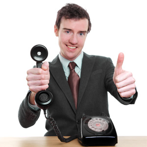 "Thumbnail image for article ""Customer Relations"". Man in a suit giving a telephone the middle finger."